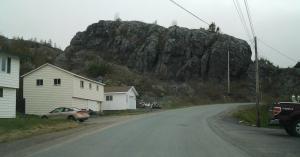 Some house built above rocks, others beside or below.