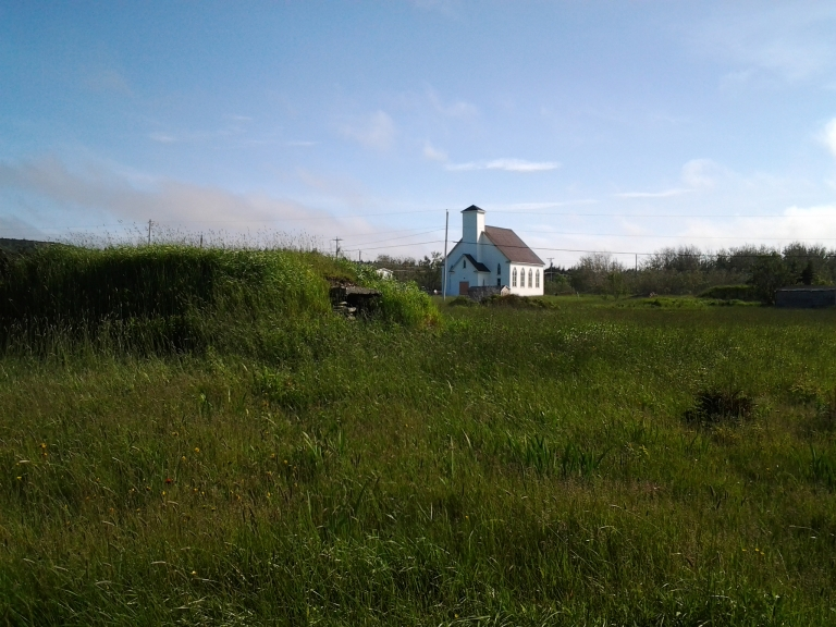 Root cellar and church in New Melbourne, NL