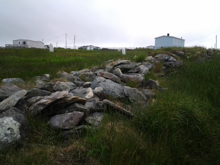 Rock wall across the road from our two story rental, Grates Cove Studio, Grates Cove, NL