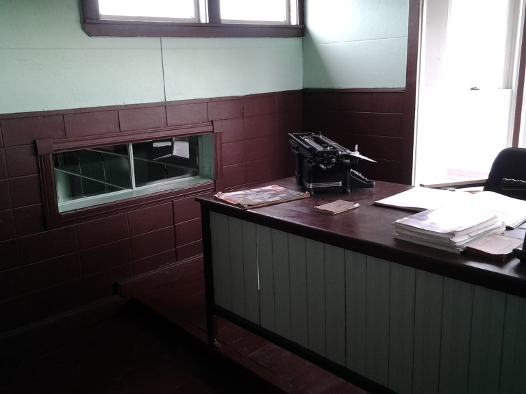 Window to lower down cash box to the store clerk, Marine Interpretation Centre, Seldom-Come-By, NL