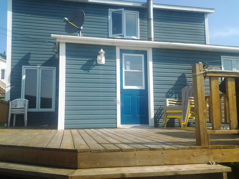 Oasis by the Sea, deck overlooks Stag Harbour, Fogo Island.