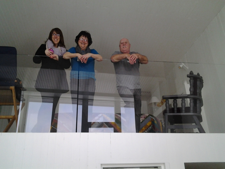 Island Harbour crowd admiring the view from the loft, Room 28, Fogo Island Inn