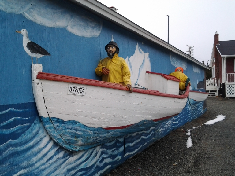 Punt I is mounted on the side of one of the buildings at the Prime Berth Twillingate History and Heritage Center.