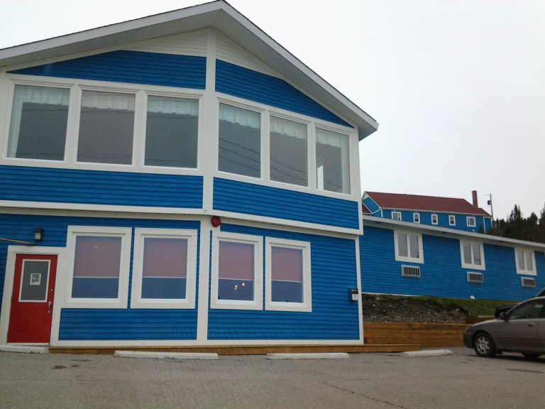 We'd seen renovations over the past few years but the large building on the hill to the right now contains new efficiency units. One and two bedroom units are available. Anchor Inn, Twillingate, NL May 2014
