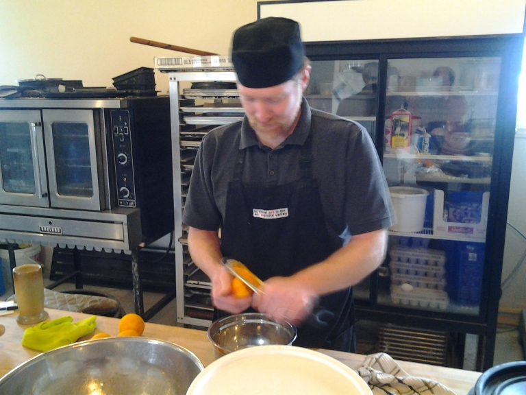 On two visits, I still haven't seen Curtis stand still long enough to get a proper picture. Here he's grating orange zest for the next batch of scones. Flat Earth Outpost, Shoal Bay, Fogo Island.