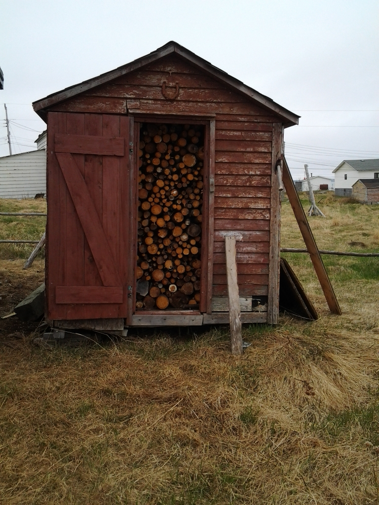 Grub store now serves as a wood shed. Build 50 years ago this August. Must be a story behind knowing that. Island Harbour, Fogo Island