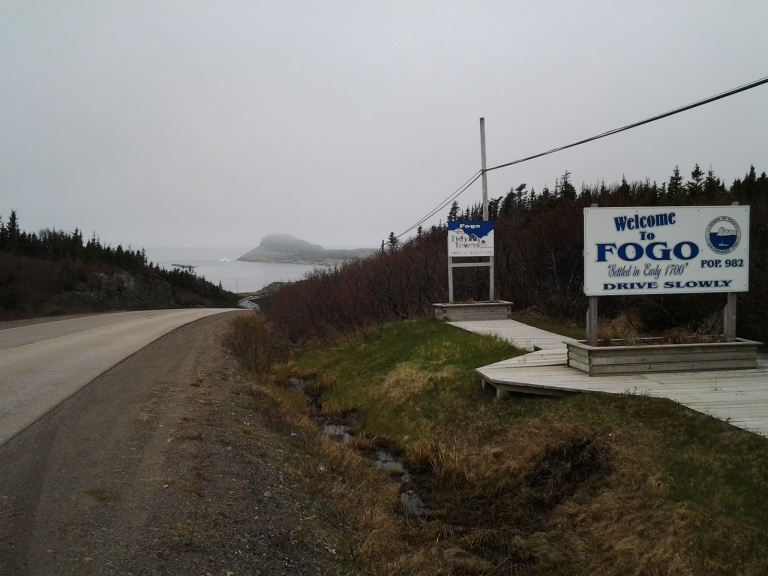 Enlarge for a hint of icebergs at the base of Brimstone Head, Fogo, NL