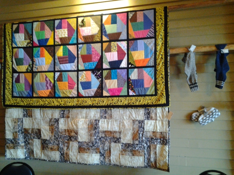 Nicole's Café, Joe Batts Arm, Fogo Island. Always quilts for sale on the walls at Nicole's.