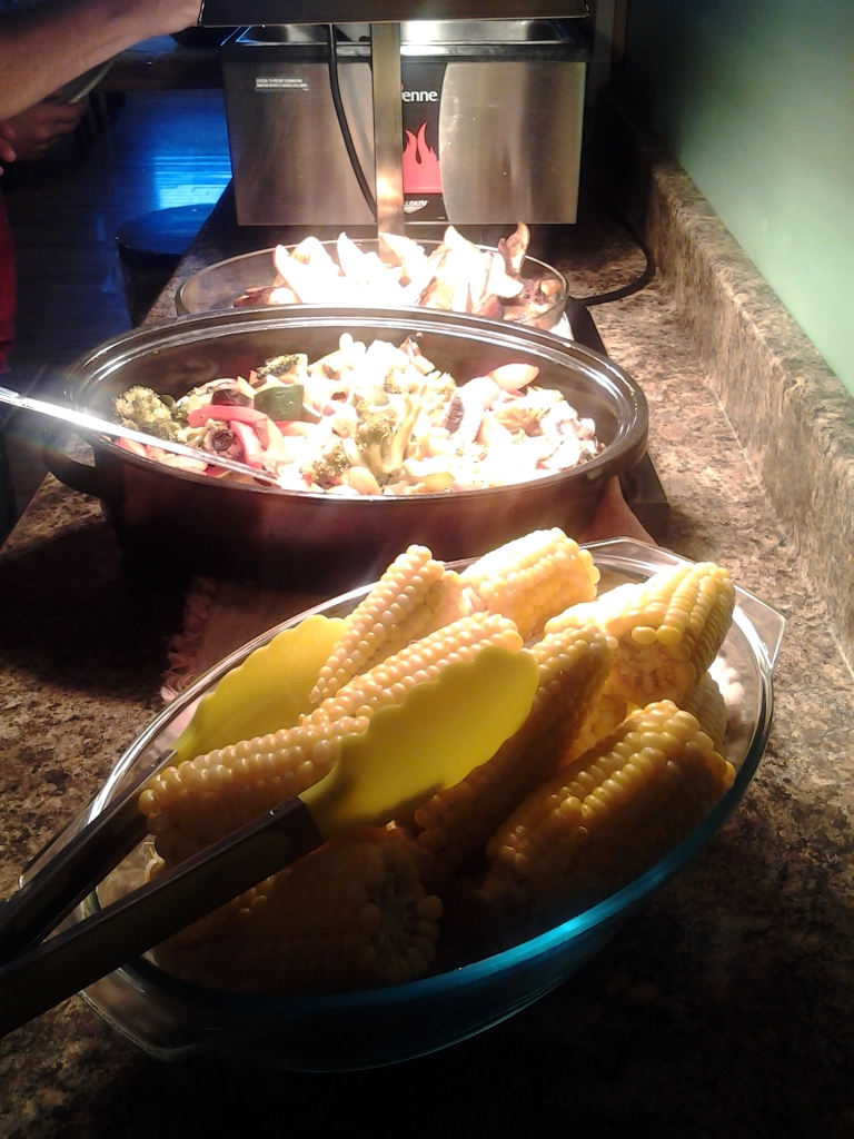 Fresh corn and other dishes on buffet at Inn at the Cape