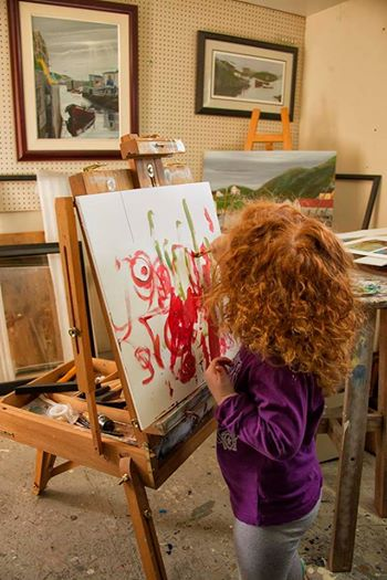 Jeff Musseau shares painting time and technique with his granddaughter.