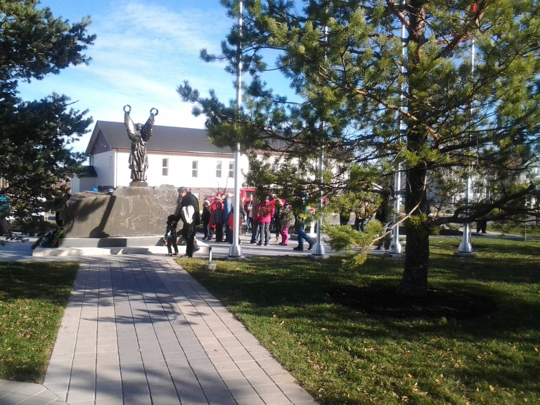 People after the ceremony admiring the new design of the Gander Memorial Heritage Park, Remembrance Day, Gander, 2014