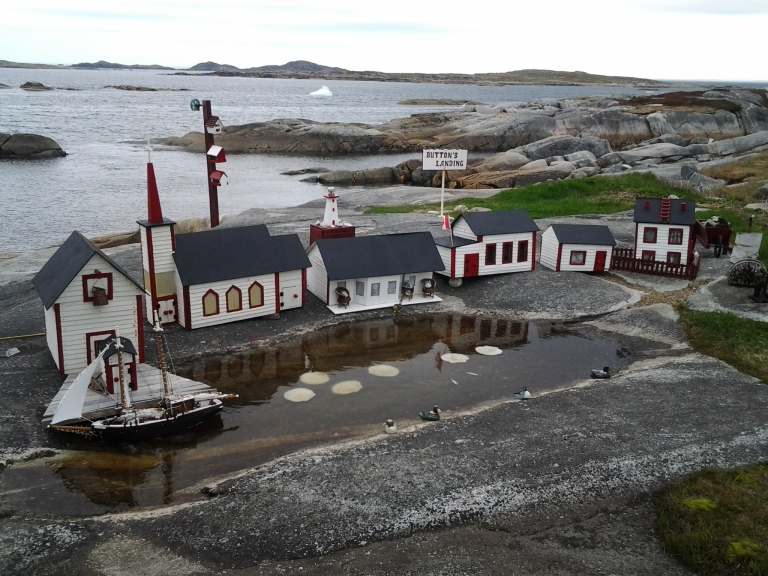 Miniature village with icebergs in the background. Greenspond, NL May 31, 2015